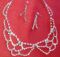 "Necklace is silver-tone metal, crystal stones, lobster clasp, 18"" long with 2"" extender. 2 stranded earrings are silver-plated metal with kidney wire backs."