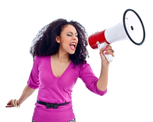 Picture of a woman with yelling into a bull horn.