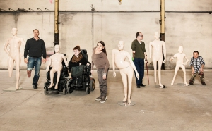 5 mannequins with physical disabilities (1 with one leg, 1 in a wheelchair, 1 with curvature of the spine, 1 with 1 foot & 1 hand and 1 little person with physical limitations)