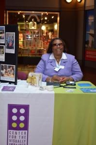 Empish Thomas at CVI Exhibit Table at Coca-Cola's Disability and Diversity Awareness Fair.