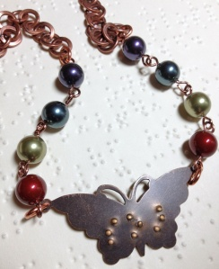 "butterfly necklace, with your choice of Swarovski pearl colors, and ""Soar"" (shown), ""Fly"", or ""Dream"" brailled on the butterfly"