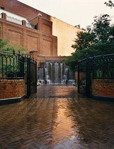 Heinz Hall Garden with open gates facing a wall of rocks waterfall Pinterest via pittsburghsymphony.org
