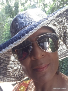 Me taking a selfie in my floppy hat and sunnies.