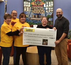 Luvfest 2014  Jami with her Brothers & Sisters holding a large check for $1,300 for the Greater Pittsburgh Food Bank