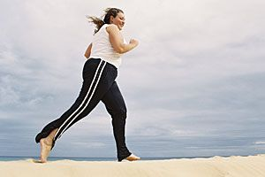 Woman running on the beach for exercise