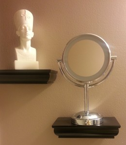 Mirror on a decorative wall shelf