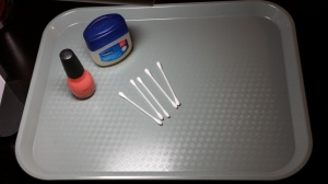 Tray with nail polish, vaseline, cotton swabs and task light