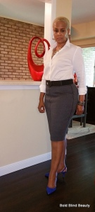 Gray pencil skirt, white button up, pointed blue suede slingback heels, hammered silver tiered statement necklace with connecting geometric shapes, silver braided cuff bracelet, silver hoop earrings with 3 alternating mesh balls and crystal rings. I'm standing facing the camera with one leg in front of the other.