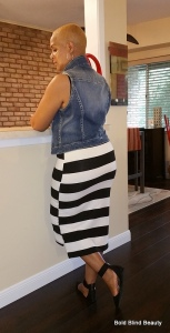 B&W striped tank dress with the blue vest. Standing facing the counter with back towards the camera for a rear short.