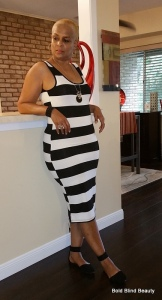 B&W stripped tank dress without the vest. I'm standing, leaning my back against the counter.