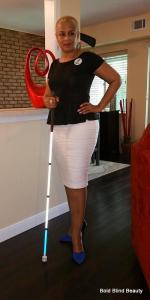 Frontal standing pose (in front of my counter) with my white cane