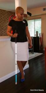Frontal standing pose with white cane in front of counter