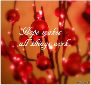 Hope makes all things work, (Image is varying sizes of red glittered, matte & shiny Christmas bulbs on red branches with miniature white lights)