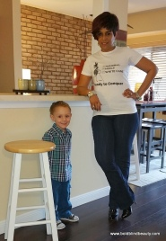 Me and my grandson Orion standing in front of the kitchen counter.