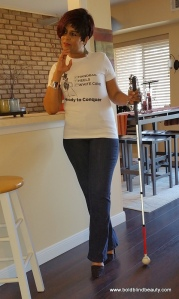 Here I am posed in a standing position with my white cane.
