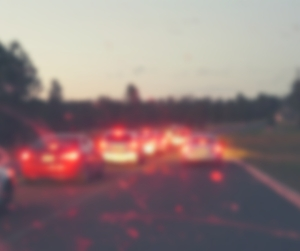 Blurred image of cars on the highway from passenger's perspective.