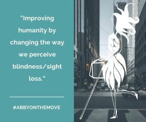 "#AbbyOnTheMove ""Improving humanity by changing the way we perceive blindness/sight loss."" Abigail is pictured crossing a city street."