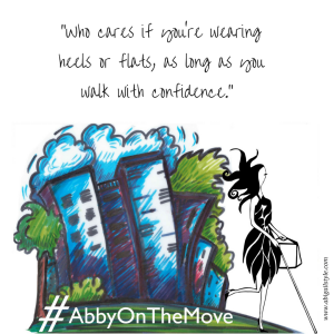 """""""Who cares if you're wearing heels or flats, as long as you walk with confidence."""" Image: A whimsical image of a blue cityscape with Abigail walking past and the hashtag #AbbyOnTheMove on the bottom."""