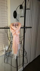 Example of the knot with a peach colored scarf on a decorative vintage dress form.