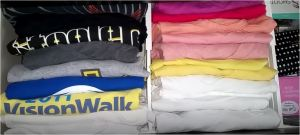 Drawer full of multi colored tees separated with dividers