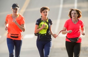 Rick Egan | The Salt Lake Tribune L-R Suzette Hirst, Becky Andrews, and Brenda Petersen. Hirst and Peterson ran as Becky's guide in the Boston Marathon, and take turns guiding her, nearly everyday, as they run in their Bountiful neighborhood. Friday, July 23, 2015.