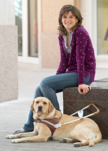 Rick Egan | The Salt Lake Tribune Becky Andrews with her third guide dog, named Georgie, in downtown Salt Lake City, Wednesday, August 12, 2015.