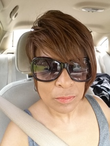 Selfie of me with my shades on in my son's car.