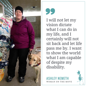 Ashley and her guide dog, Rick are posed with her snowboard.